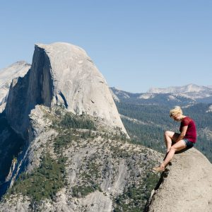 a man riding on top of Half Dome
