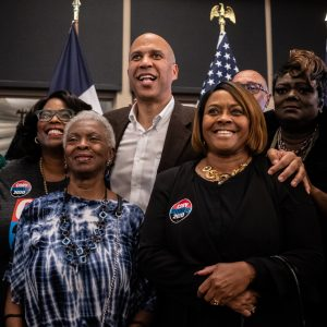 Cory Booker et al. posing for the camera